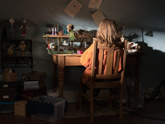Charlie (Milly Shapiro) creates makeshift toys out of branches, pill bottles and bird heads in her bedroom.