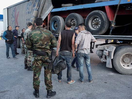 Greek port police find and arrest two migrants that