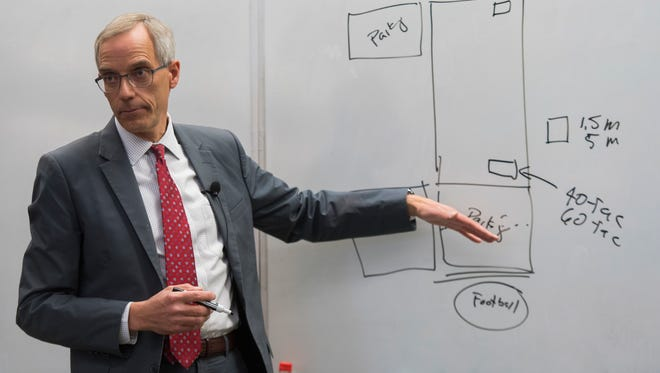 Southern Utah University president Scott Wyatt draws a map showing future projects during a community meeting in the Hunter Conference Center at SUU Wednesday, April 11, 2018.