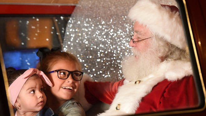 Zaniyah Cervantes, 9, and her sister, Zayd Cervantes, 1, visit Santa Claus during Downtown Austin Alliance's Holiday Sing-Along and Downtown Stroll in 2018. This will be a year to skip the visit to Santa or to see him from afar.
