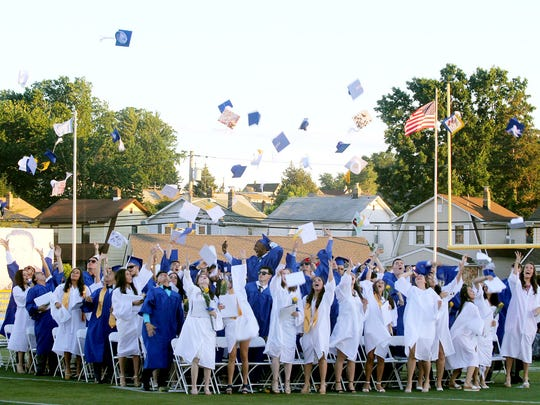 The tossing of the caps at the ceremony's conclusion