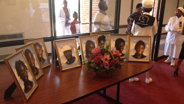 Headshots of Todd family members are displayed in the Ella Fitzgerald center at UMES.