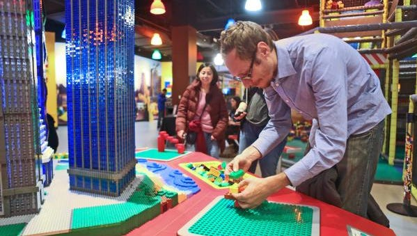 Brandon Wynenga of Manhattan builds a Lego creation in Legoland at Ridge Hill in Yonkers during Adult Fans of Legos night.