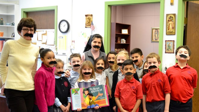 "Second graders at Bishop Schad Regional School in Vineland along with school principal, Sister Rosa Maria, and school secretary Jane Lambert show off their ""big bushy mustaches."""