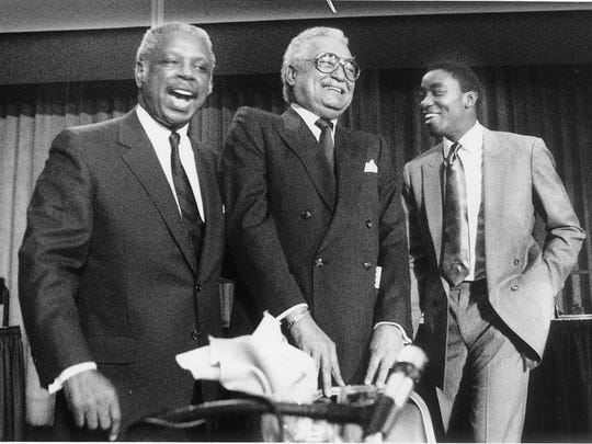 Sixth Circuit Court of Appeals Judge Damon Keith, left, Detroit Mayor Coleman Young, center, and Isiah Thomas of the Detroit Pistons attend a roast at Cobo Hall in downtown Detroit on Nov. 17, 1987.