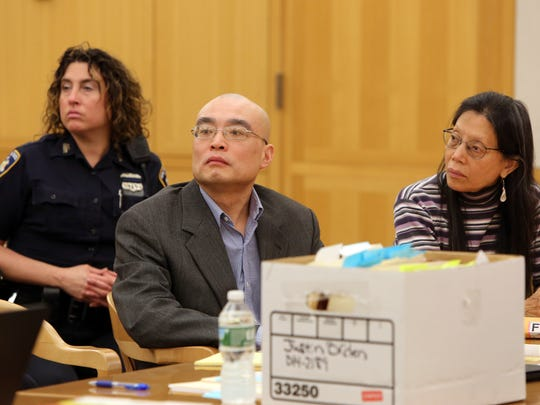 Hengjun Chao, left, with a Mandarin interpreter seated beside him, listens to his attorney's opening statement on the first day of his trial for trying to kill his former boss, Dr. Dennis Charney, at Lange's in Chappaqua last summer, June 5, 2017 at Westchester County Courthouse in White Plains.