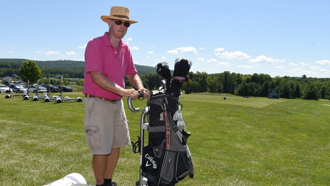 Chuck Clifton, of Garrison, prepares to head to the first tee at The Links at Union Vale on Wednesday. Clifton began using GolfBoards immediately, praising them as a 'fun' addition to his golf game.