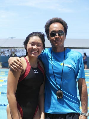 Samantha Hon and her Tsunami Swim Club coach, Toshiki Iijima.