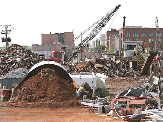 Downtown Sioux Falls can be seen over the work going