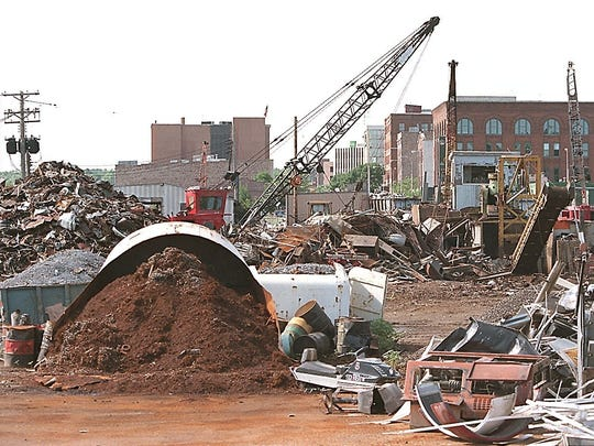 Downtown Sioux Falls can be seen over the work going on at Pitt's Inc.