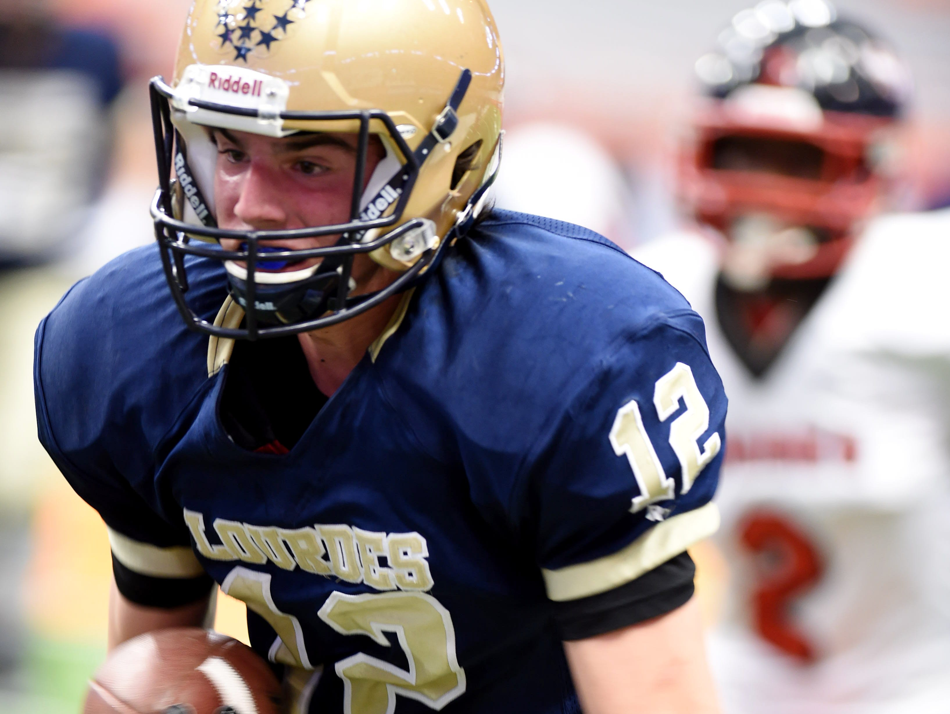 Lourdes' Luke Timm carries the ball during the New York State Championship final versus South Park in Syracuse on Friday.