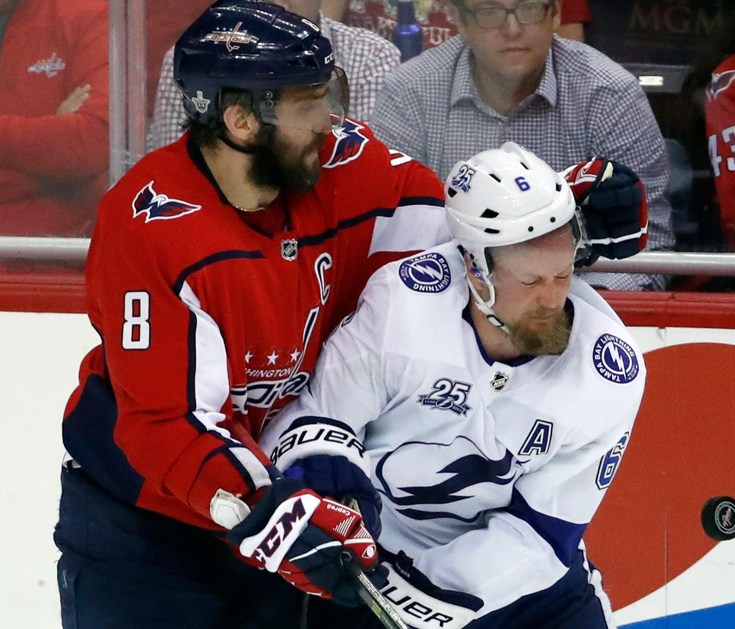 Washington Capitals left wing Alex Ovechkin (8), from Russia, collides with Tampa Bay Lightning defenseman Anton Stralman (6), from Sweden, during the third period of Game 6 of the NHL Eastern Conference finals hockey playoff series, Monday, May 21,