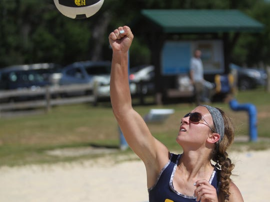 Community Christian's Abbie Post punches a ball over the net at the 2018 Tallahassee high school beach volleyball city tournament at Tom Brown Park