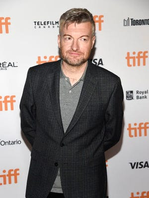 """FILE - In this Sept. 12, 2016 file photo, Charlie Brooker, the creator, writer and executive producer of """"Black Mirror,"""" poses at the premiere of the new season at the Toronto International Film Festival in Toronto. The anthology series takes you through a high-tech looking glass with jittery tales sure to lodge in your brain for years to come. It reclaims the hallowed realm of """"The Twilight Zone"""" for a new millennium."""