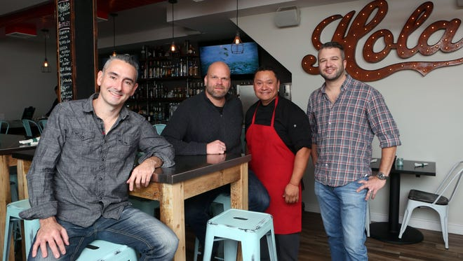 Chef Dennis Cruz, second from right, with co-owners John Gallagher, left, Clayton Bushong and Brenan Hefner at Cantina Lobos in Pelham.