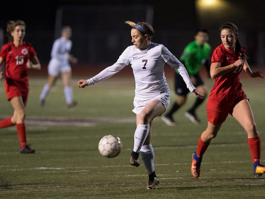 Calallen's Dana Curtis passes the ball to a teammate