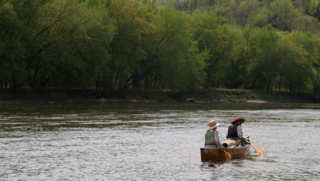 Above, Ben Hoksch and Libby Abbas of Des Moines canoe down the Des Moines River in May 2015 in Boone County. The couple is paddling the entire length of the river.