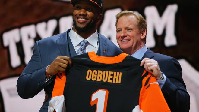 Cedric Ogbuehi poses for a photo with NFL commissioner Roger Goodell after being selected as the No. 21 pick by the Bengals in the first round of the 2015 NFL Draft.