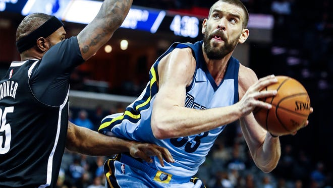 Memphis Grizzlies center Marc Gasol drives for a basket against the Brooklyn Nets defense during second quarter action at the FedExForum in Memphis, Tenn., Sunday, November 26, 2017.