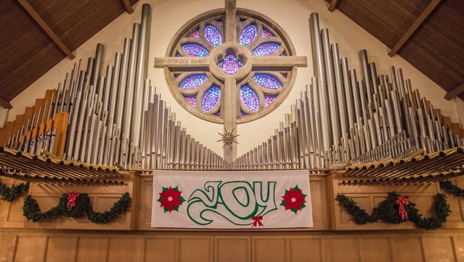 Christmas decorations adorn the organ at Central United Methodist Church, 1425 E. Main St. on Tuesday, Dec. 12, 2017.