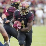 Florida State Seminoles running back Dalvin Cook (4) scores a touchdown against the Chattanooga Mocs at Doak Campbell Stadium.