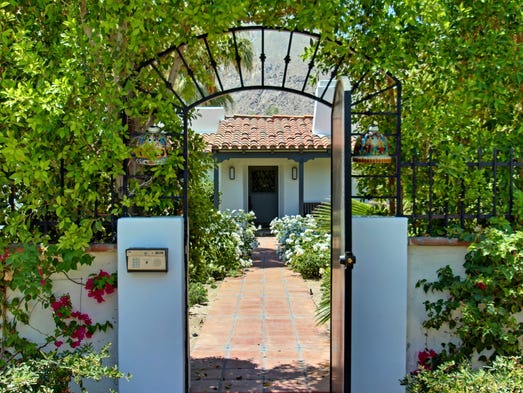 The Old Las Palmas home on a corner lot boasts Spanish details.