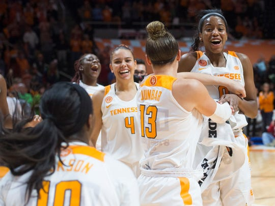 The Lady Vols celebrate their 71-69 win over No. 6