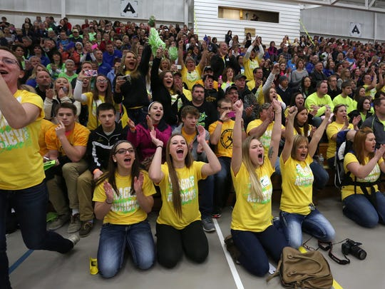 D.C. Everest pom team supporters cheer the dancers after they finished their routine at the regional dance championship Saturday at D.C. Everest Senior High School in Weston. The team took second and earned a trip to state.