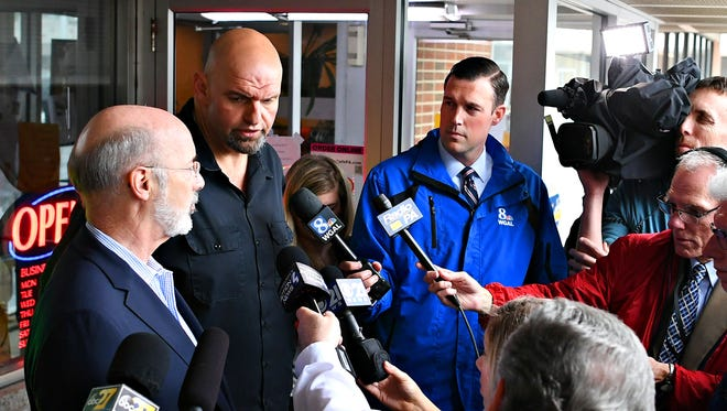 Gov. Tom Wolf and newly elected Lt. Gov. running mate John Fetterman speak to the media at Manchester Cafe in Manchester Township, Wednesday, May 16, 2018. Dawn J. Sagert photo