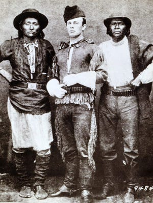 Indian agent John Clum with Diablo and Eskiminzim at San Carlos Agency in 1875.