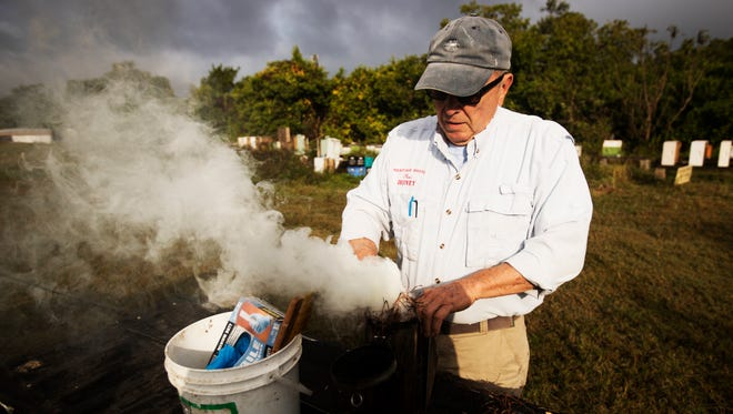 Don Murray, the owner of Heritage Pointe Pure Honey prepares to check on some of his hives in south Fort Myers.