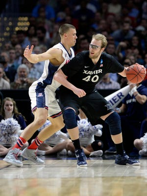 Xavier Musketeers center Matt Stainbrook (40) moves to the basket against Arizona Wildcats center Kaleb Tarczewski (35) during the second half in the semifinals of the west regional of the 2015 NCAA Tournament at Staples Center on March 26, 2015.