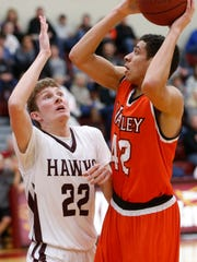 Ankeny's Deaglan Riordan defends against Valley's Mike Brown in a game from February 2017 at Ankeny High School.
