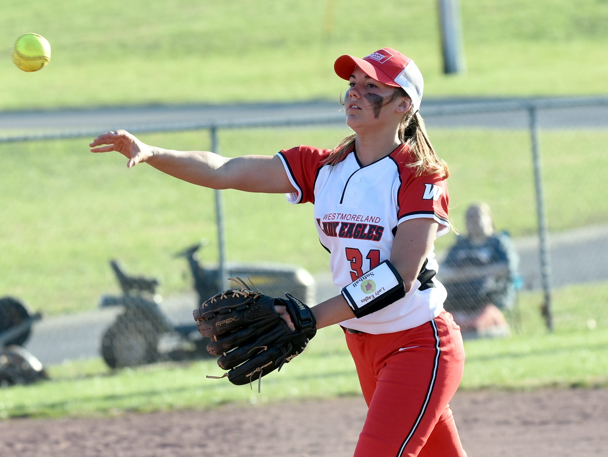 Westmoreland High junior second baseman Kimi Richardson throws to first base for a fourth-inning putout.
