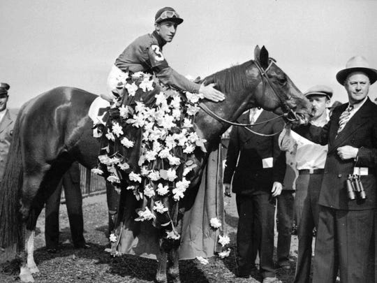 FILE--Whirlaway, with Eddie Arcaro aboard, is draped