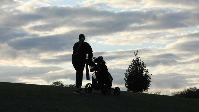 KHS golf standout Mya Mirocha pushes her cart toward the last hole of a round at Baker Park Golf Course. Park officials say the recent success of the KHS program has led to more female golfers hitting the local fairways.