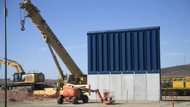 A border-wall prototype is seen among the construction of the prototypes near the Otay Mesa Port of Entry outside of San Diego, as seen from Tijuana, Mexico, on Oct. 16, 2017.