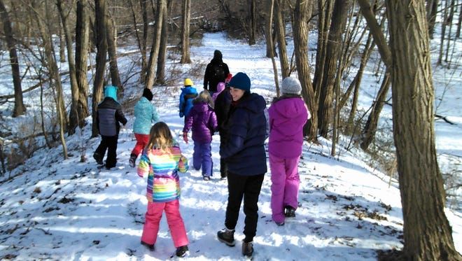 Winter trail hiking doesn't faze these elementary kids seen taking part in the Snowy Owl Camp at Macbride Nature Recreation Area Dec. 22.  This day camp is operated through Recreational Services at the University of Iowa.  Besides winter hiking and exploring, campers study things like the winter behavior of animals and birds and how freezing temperatures affect wetlands.  Registration is full, but find more info at https://recserv.uiowa.edu/snowy-owl-camp
