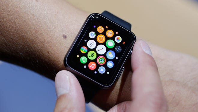 The new Apple Watch is shown during a new product release on Tuesday, Sept. 9, 2014, in Cupertino, Calif. (AP Photo/Marcio Jose Sanchez) ORG XMIT: CAMS303
