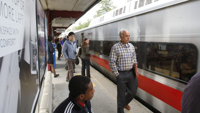 Commuters board the train at Metro-North Mount Vernon West Station.