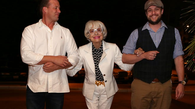 """Carol Channing walks into the Camelot Theatres in Palm Springs with Berndt Heidemaman, left, and Camelot Theatres general manager Matthew Christensen prior to the screening of a documentary, """"Advanced Style"""" in Palm Springs on Friday."""