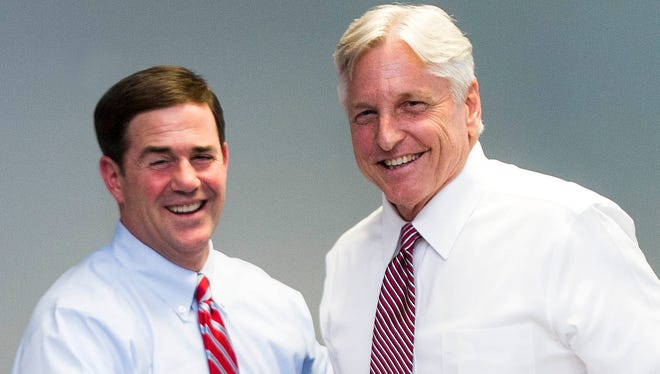 Gubernatorial candidates Doug Ducey (left) and Fred DuVal greet each other after meeting with The Arizona Republic editorial board on Oct. 1, 2014.