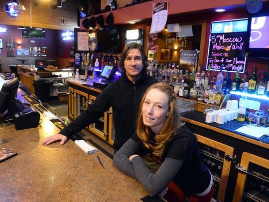 Doug Palagi, owner of The Do Bar, left, with bar supervisor