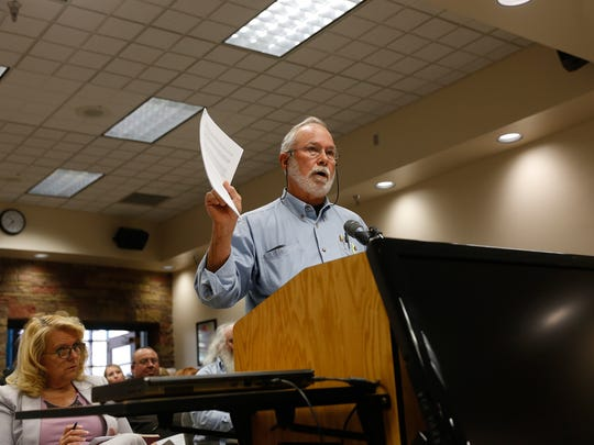 AV Water company customer Bernie Volz addresses members of the New Mexico Public Regulation Commission Wednesday during a meeting at the San Juan County Commission chamber.