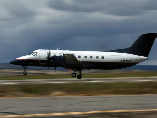 Great Lakes Airlines airplane takes off for Denver,