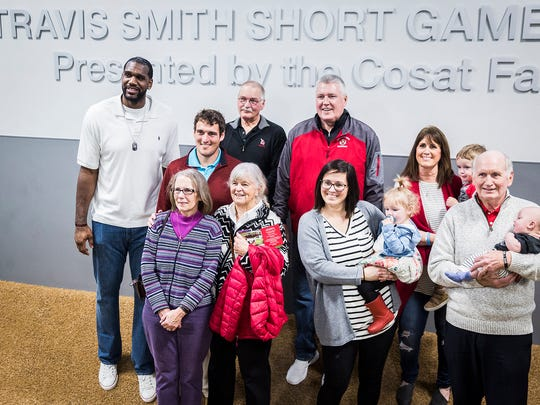 Former NBA player Greg Oden joins family members of Ball State golf player Travis Smith for a photo while at the Earl Yestingsmeier Golf Center. Jimmy and Tami Smith are in the back row. The facility's short game area was named after the late player who was also friends with Oden.