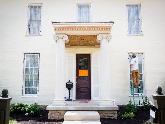 """Work continues on the historic Thomas Neely Homestead on E. Adams Street Tuesday afternoon. Local business partners are renovating the more than 165-year-old structure and turning it into an """"upscale dining"""" restaurant."""