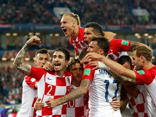 Croatia players celebrate after their second goal against