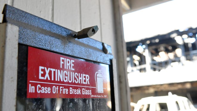 A locked fire extinguisher at 1337 Garner Avenue, where a fast-moving, three-alarm blaze consumed nine vehicles and two residential units on Saturday in Salinas. No one was injured.