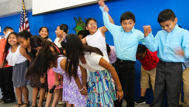 "Immokalee Community School third- and fourth-graders take a bow after reciting their poems in front of students, teachers and family members Friday, May 26, 2017. Fifteen ICS students will be published in the fall issue of ""A Celebration of Poets."""